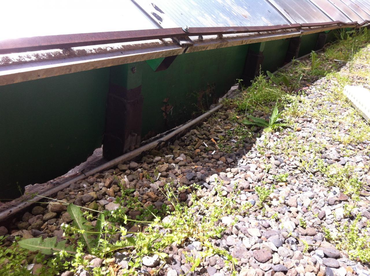 le sous bassement de la toiture galerie en mauvais état